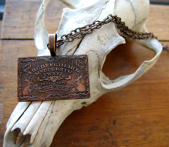 Jackalope Ouija necklace by Cheshworth