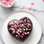 whole ganache heart with a bowl of sprinkles