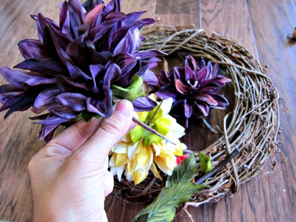 using fake flowers to make a wreath