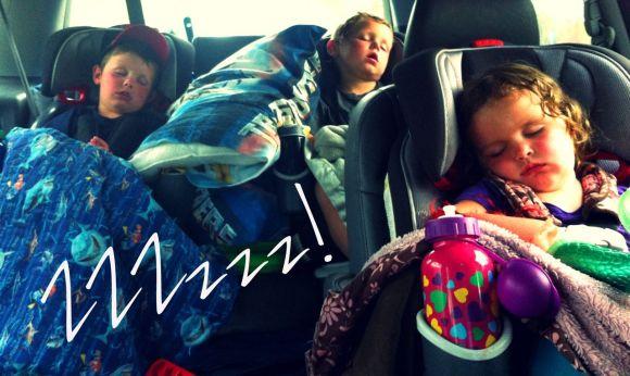 kids asleep in van