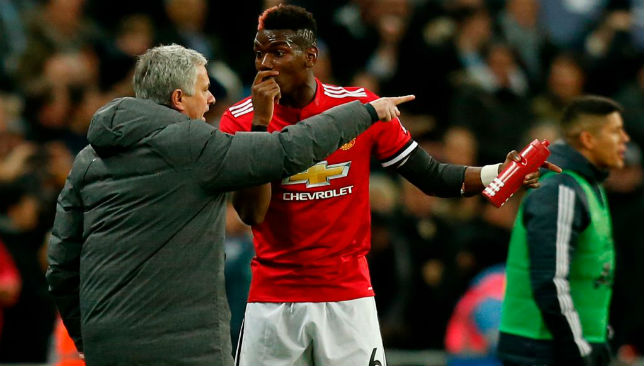 Jose Mourinho (L) talks with Manchester United's French midfielder Paul Pogba