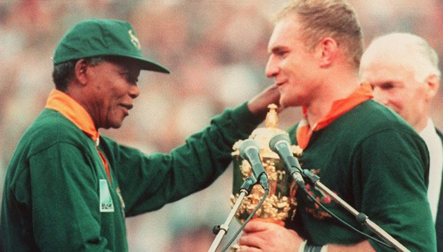 Francois Pienaar receives the 1995 World Cup from Nelson Mandela.
