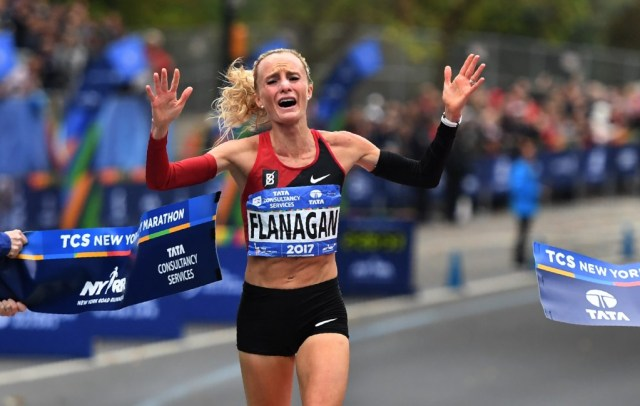 TOPSHOT - Shalane Flanagan of the US celebrates after crossing the finish line to win the Women's Division during the 2017 TCS New York City Marathon in New York on November 5, 2017. Five days after the worst attack on New York since September 11, 2001, the city is staging a show of defiance on November 5, as 50,000runners from around the world are set to participate in the New York Marathon, under heavy security. / AFP PHOTO / TIMOTHY A. CLARY (Photo credit should read TIMOTHY A. CLARY/AFP/Getty Images)