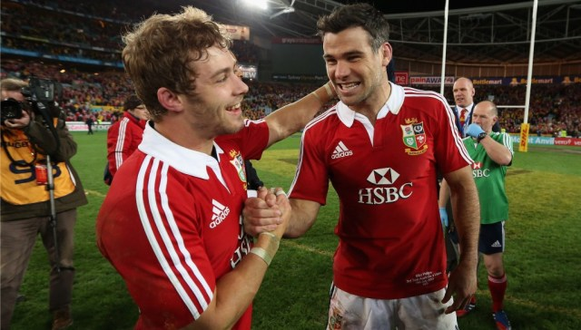 Mike Phillips celebrates with compatriot Leigh Halfpenny after the British & Irish Lions secured a series win over Australia in 2013.