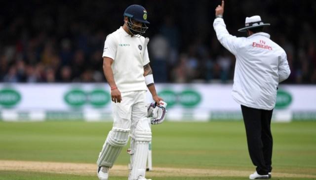 Virat Kohli trudges off after being dismissed by Stuart Broad