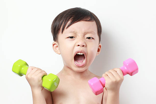 child lifting weights dr