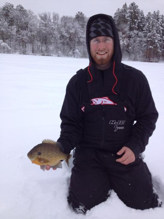 """Dale Luginbill with an 11"""" bluegill"""