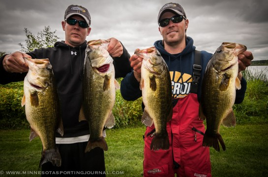 Mike Lien and Willy Wicks with the 6.12 lb bass and other fish from day 1.