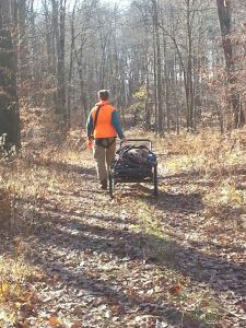 The author's son hauls out the gear on what might be the last hunt in a special spot