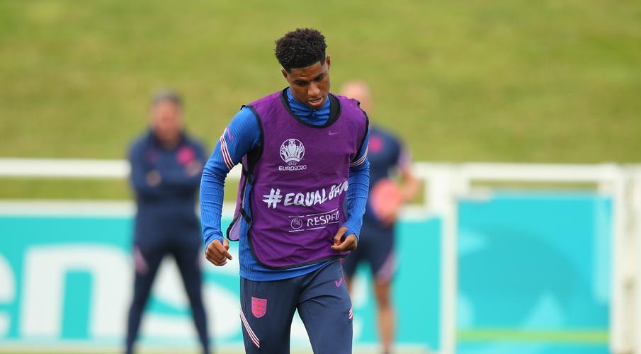 Rashford back at United's training base after shoulder surgery