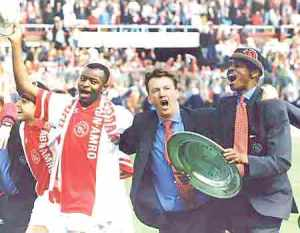 Finidi, Van Gaal and Kanu with club title.