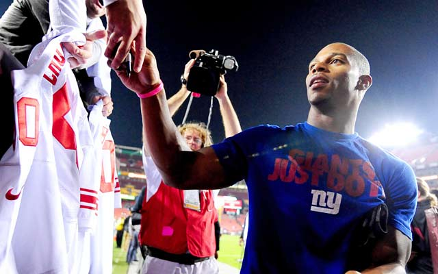 Victor Cruz hopes the Giants listen to the slogan on his t-shirt.   (USATSI)