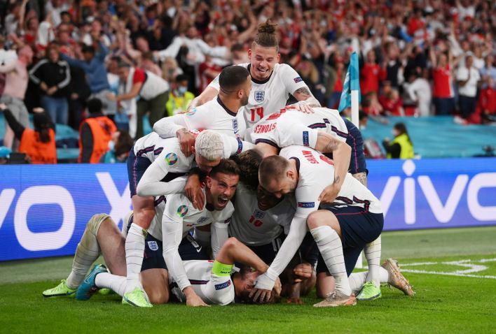 England's Harry Kane celebrates scores their second goal with teammates Pool via