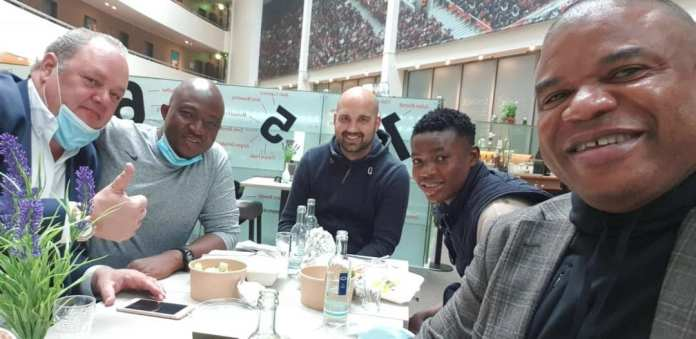 Agent Peter Obiora Ejiasi (far right) with Fatawu and others at the hotel in Germany booked by Leverkusen