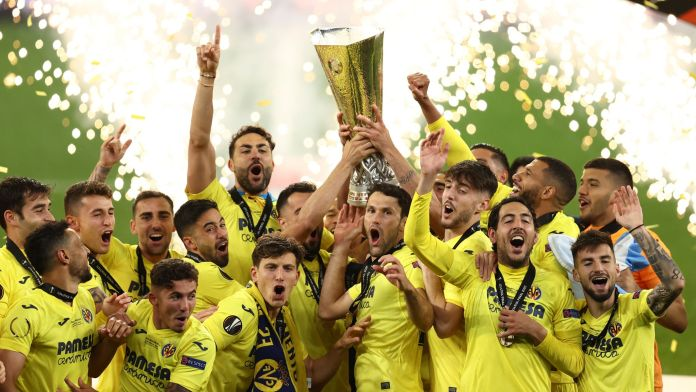 Villarreal players celebrate with the trophy after winning the Europa League