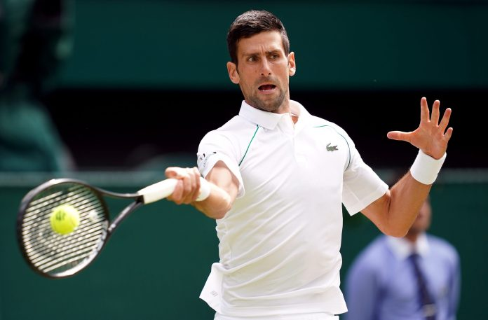 Novak Djokovic in action during the Gentlemen's Singles final against Matteo Berrettini on day thirteen of Wimbledon at The All England Lawn Tennis and Croquet Club, Wimbledon. Picture date: Sunday July 11, 2021.