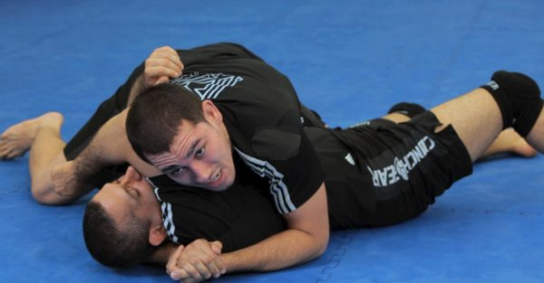 How to Do a Rolling Arm Bar from Guard
