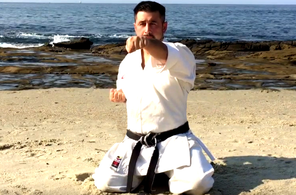 This is a Sensei practicing Karate at the Beach