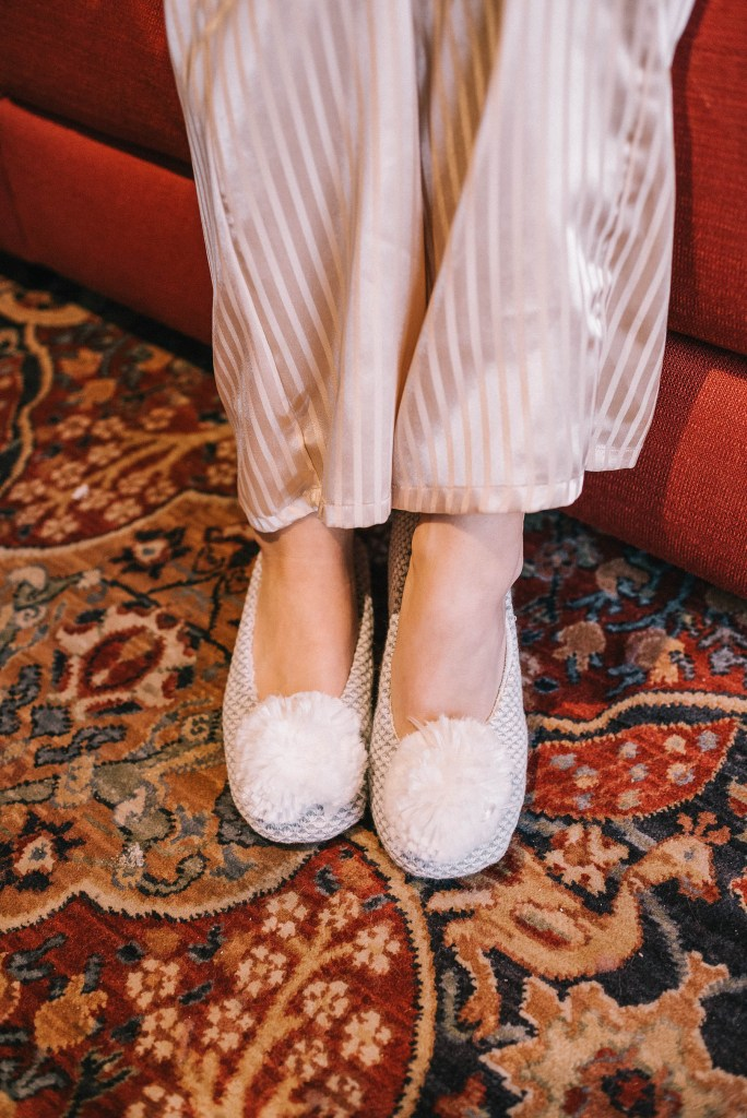 pom pom slippers and silk pajamas
