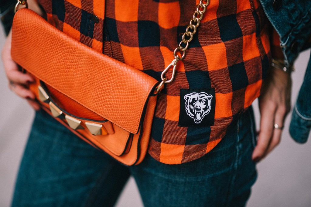 Blogger Mary Krosnjar wearing Linea Pelle Crossbody and Chicago Bears Levis Flannel