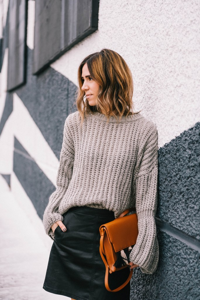 Blogger Mary Krosnjar wearing Grey Bell Sleeve Oversized Sweater and faux leather skirt