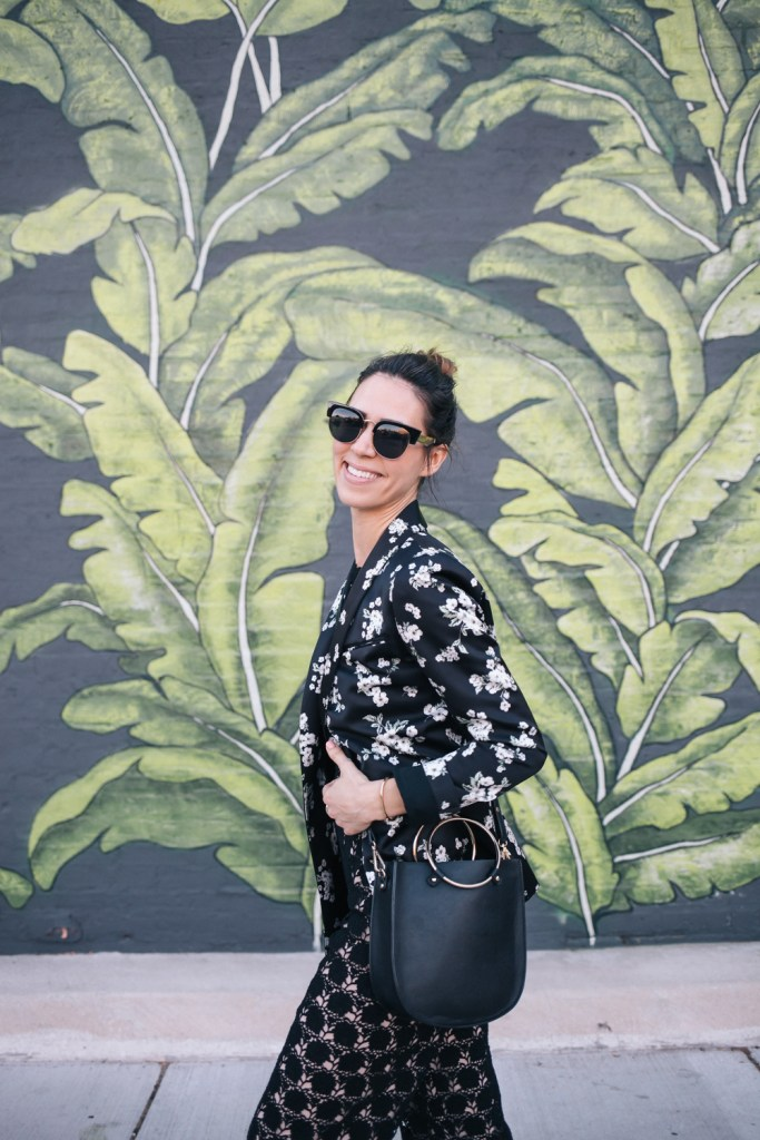 Blogger Mary Krosnjar wearing Floral Blazer and Lace jumpsuit from Rent the Runway