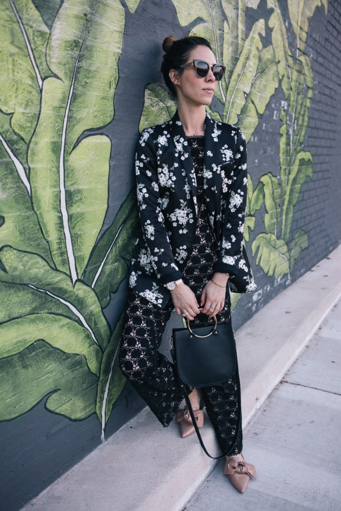 Blogger Mary Krosnjar wearing Zara flats with bows and Lace jumpsuit from Rent the Runway