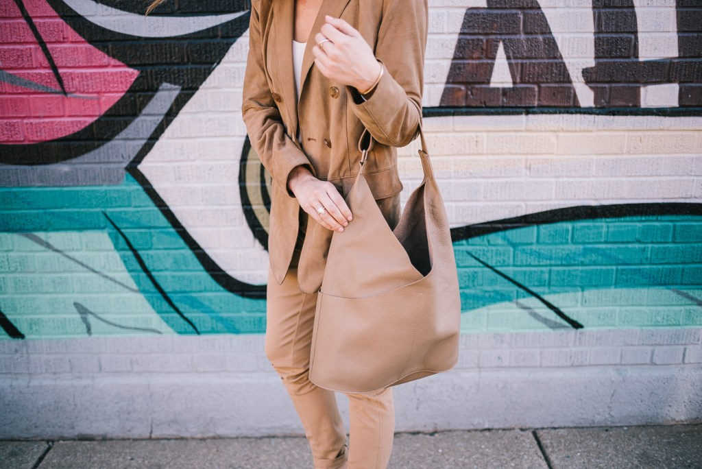 Blogger Mary Krosnjar wearing suede large tote and Pantsuit Nation