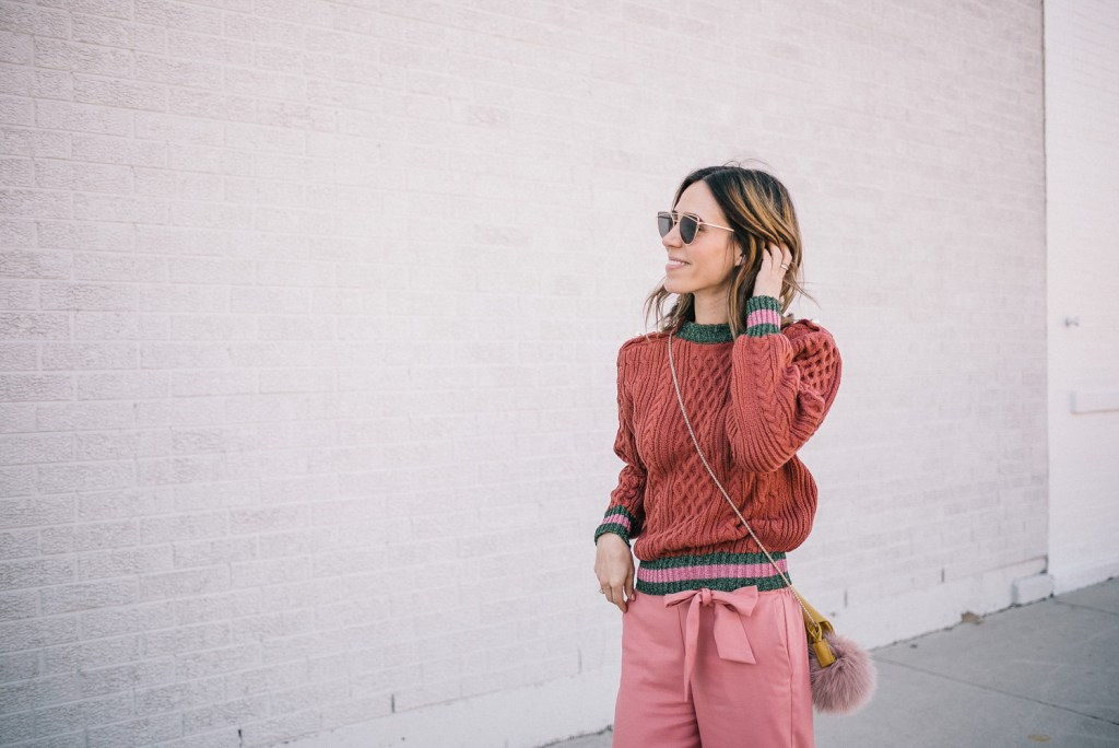 Blogger Mary Krosnjar wearing Storets Lace Sweatshirt and Pink cropped pants with Valentinos