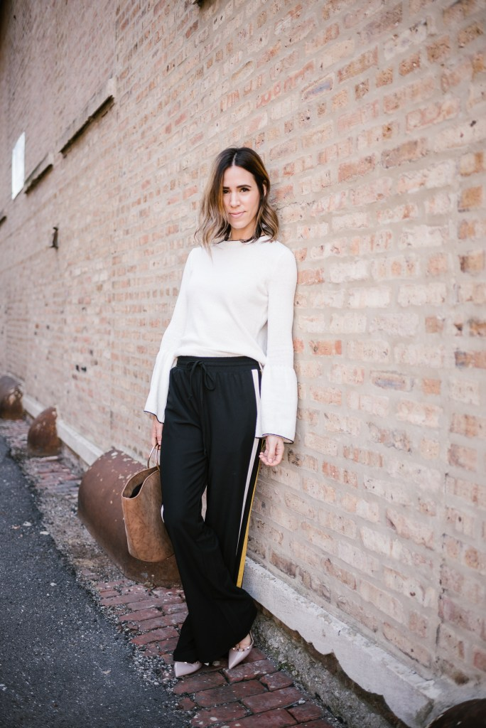 Blogger Mary Krosnjar wearing Who What Wear Target Collection, Track Pants and Valentino Pumps