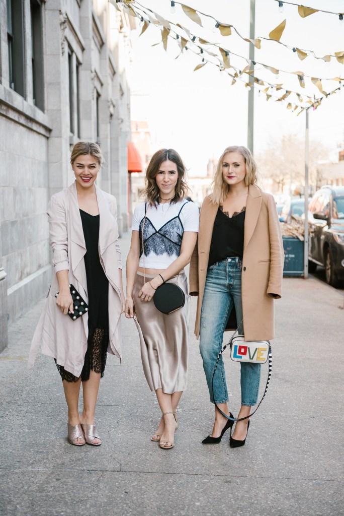 Lauren Kelp wearing pink duster coat, Mary Krosnjar wearing lace overlay cami top, Ali Stone wearing camel robe coat