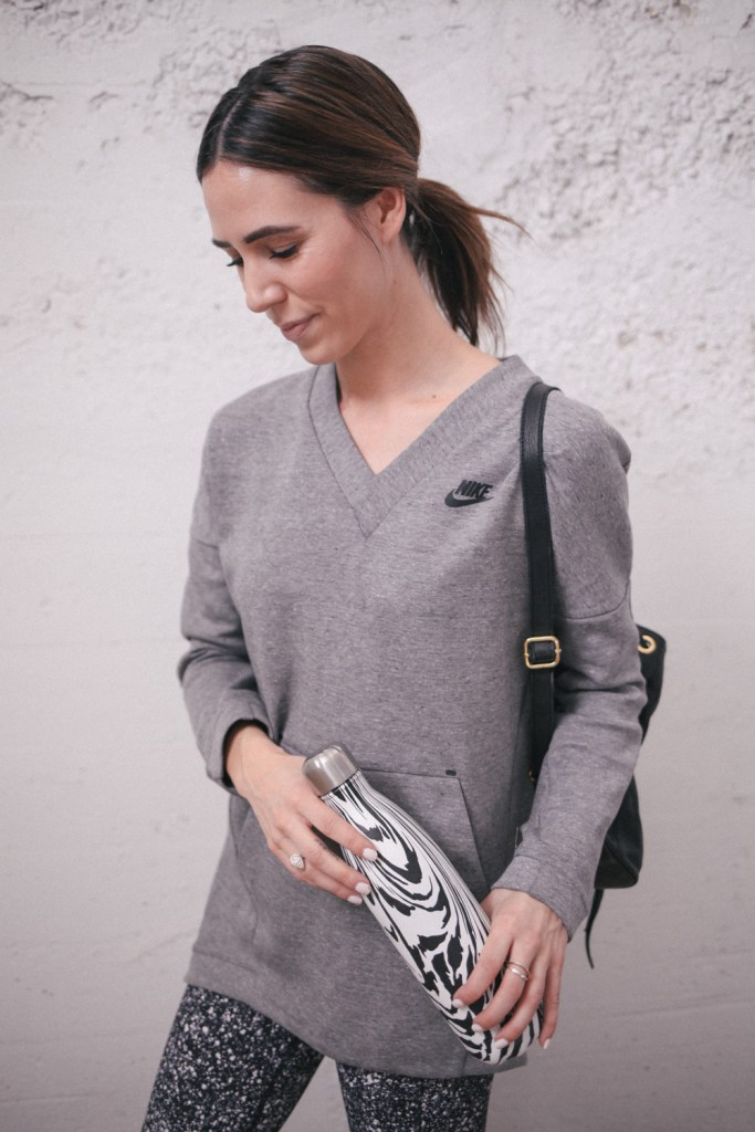 Blogger Mary Krosnjar wearing Nike pullover and Swell water bottle