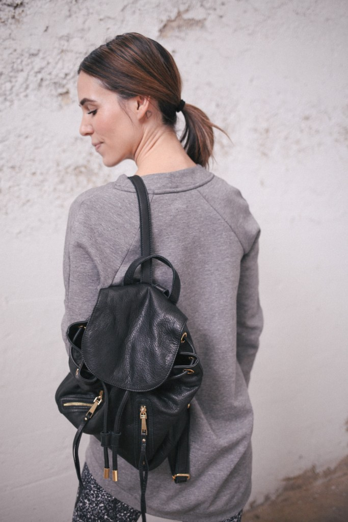 Blogger Mary Krosnjar wearing Nike Pullover and Linea Pelle leather backpack