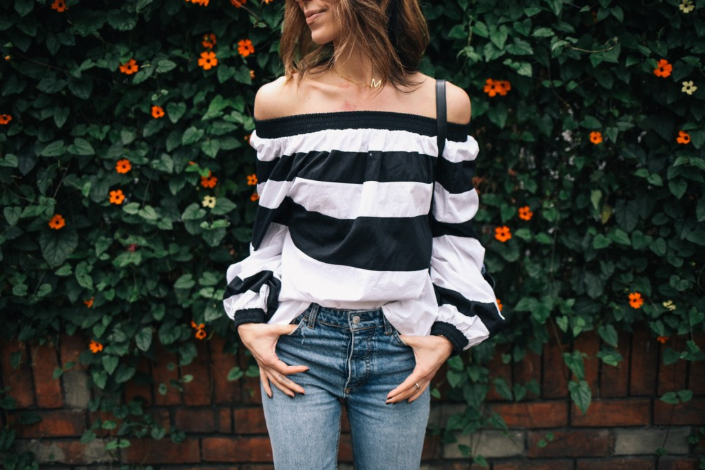 Blogger Mary Krosnjar wearing MLM Label Off the Shoulder Top and H&M High-waisted denim