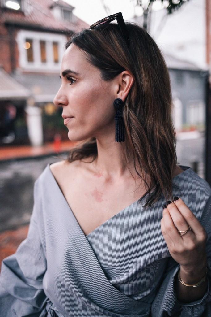 Blogger Mary Krosnjar Wrap ruffle sleeve top and oscar de le renta earrings