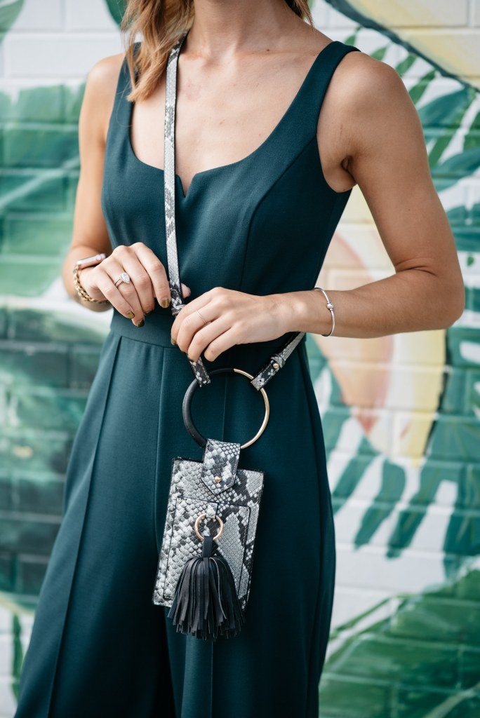 Blogger mary krosnjar wearing snake skin phone pouch by who what wear