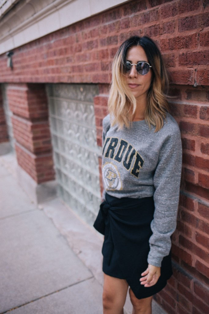 Blogger Mary Krosnjar wearing Purdue University Vintage Pullover sweater with Womens tie skirt