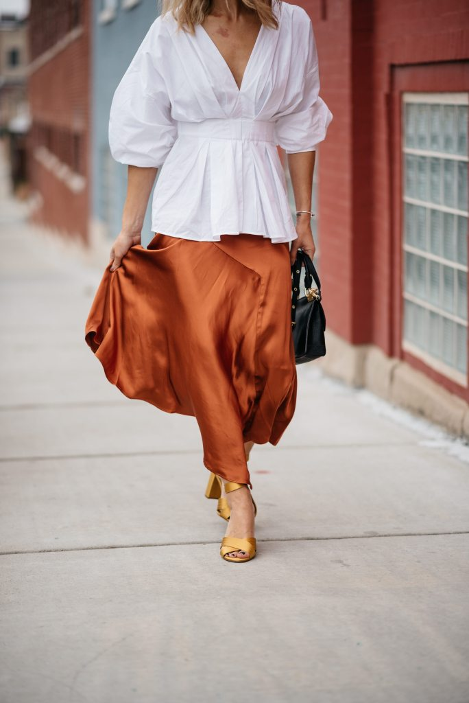 Blogger Mary Krosnjar styling Rust Satin Skirt with Ann Taylor Satin Sandals