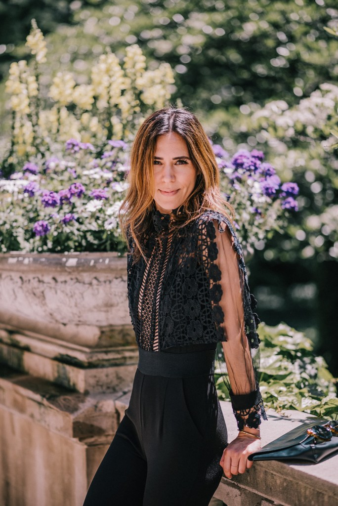 Blogger Mary Krosnjar wearing Lace Crochet Jumpsuit and J.Crew black clutch