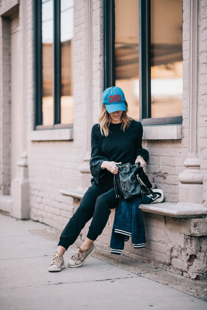 Blogger Mary Krosnjar wearing Linea Pelle Leather backpack and Ann Taylor joggers