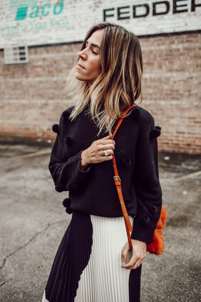 Blogger Mary Krosnjar wearing Rachel Parcell Black Pom Pom Sweater and short hair bayalage