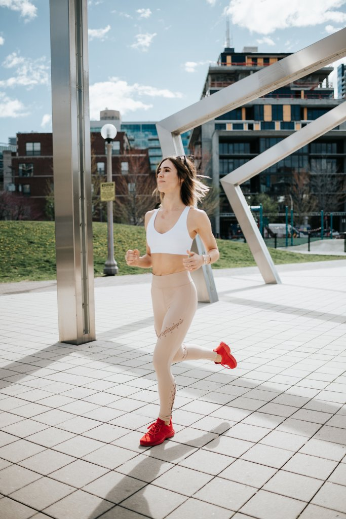 Blogger Mary Krosnjar wearing APL Sneakers and Contour lace up leggings