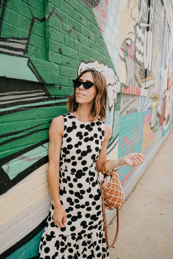 Blogger Mary Krosnjar wearing Polka Dot Sleeveless Ruffle Dress and Cat Eye Sunglasses