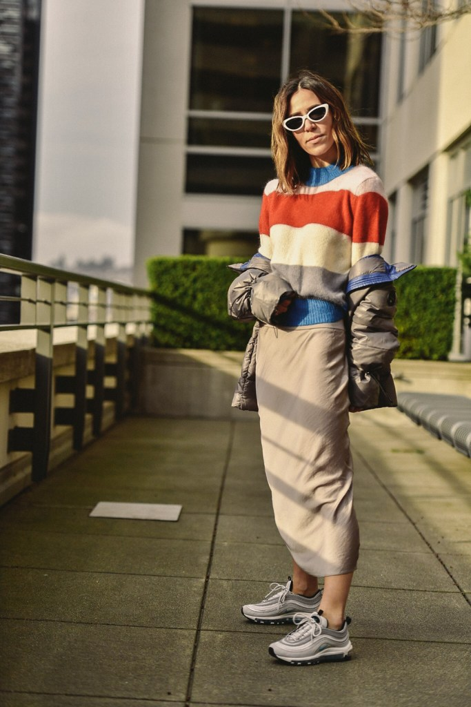 Blogger Sportsanista wearing Free People Normani Bias Cut Satin Skirt and Nordstrom Signature Striped Sweater