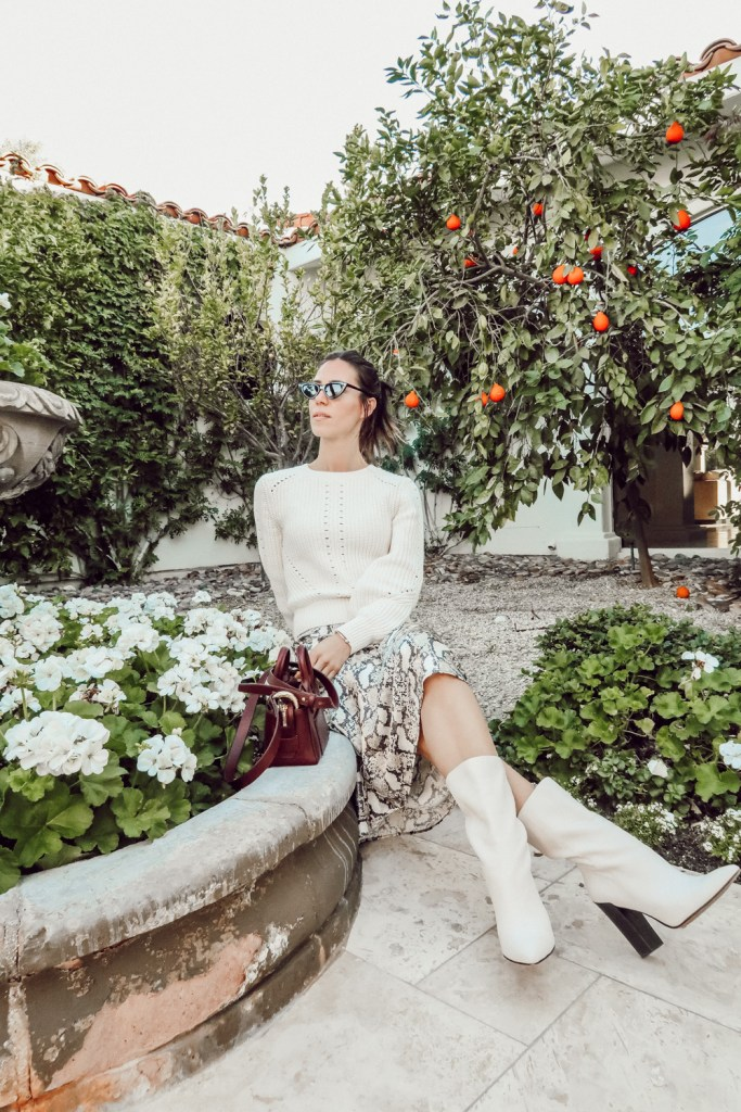 Blogger Mary Krosnjar in Palm Springs wearing Women's LC Lauren Conrad Fuzzy Balloon-Sleeve Sweater and H&M Calf Length Skirt