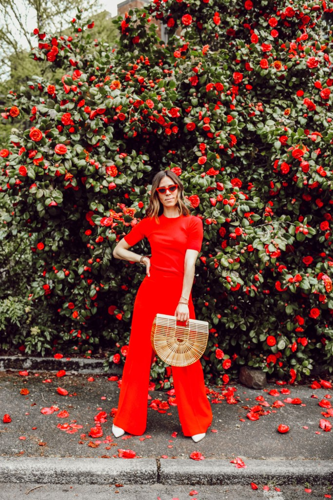 Seattle Fashion Blogger wearing red ribbed tee and red wide leg pants
