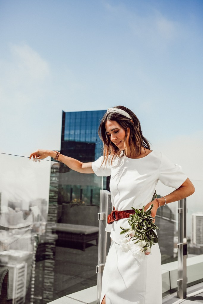Seattle Fashion Blogger Sportsanista on Seattle Rooftop wearing White blouse and Woven belt for work