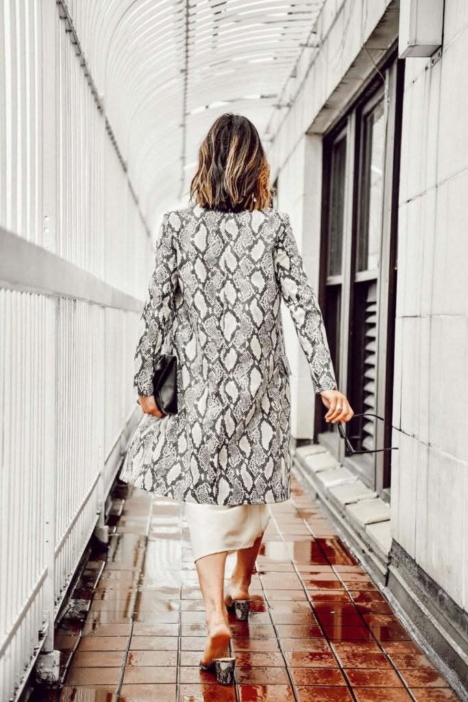 Seattle Fashion Blogger Sportsanista wearing Snakeskin coat over cream slip dress