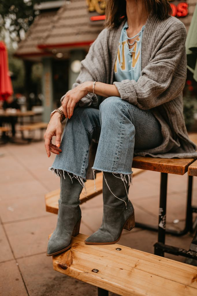 Seattle Fashion Blogger Sportsanista wearing Sam Edelman Suede Slouchy Boots and Levi's Cropped Denim for Game Day