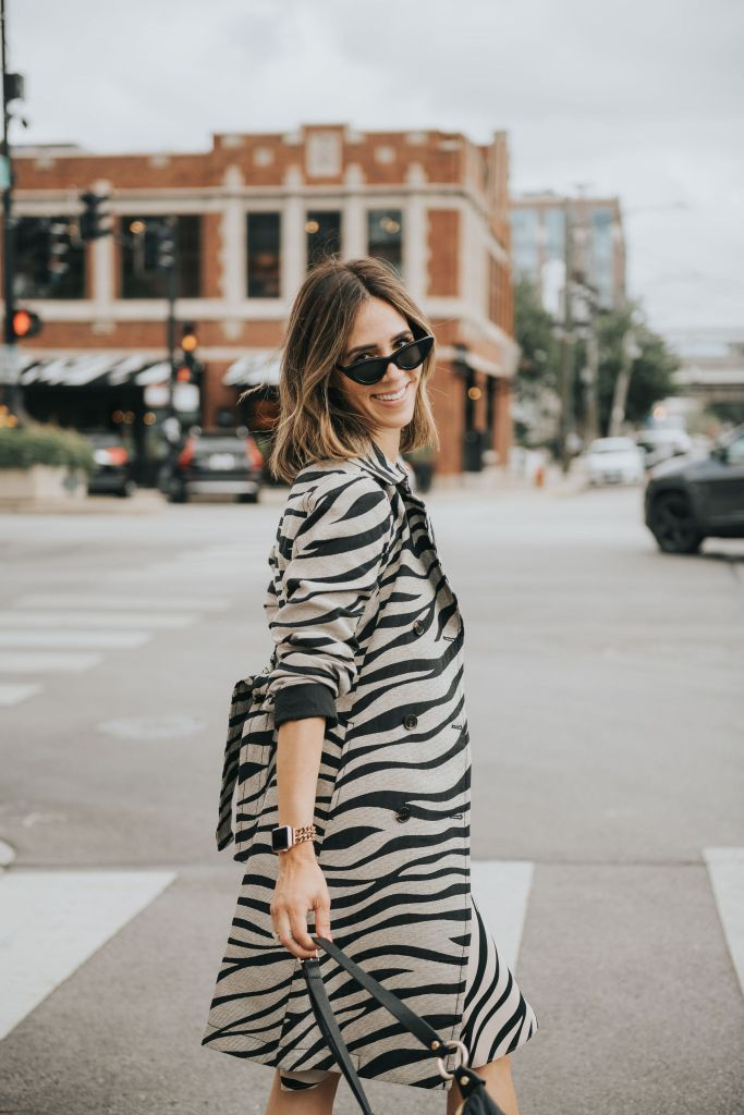 Fashion Blogger Sportsanista wearing Zebra Print Trench Coat from Ann Taylor for workwear inspiration